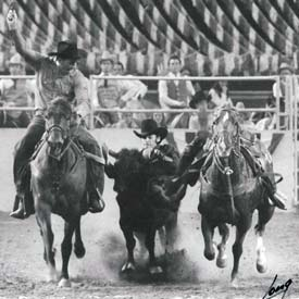 Lee in the finals at Rodeo Houston with Bill Duvall hazing